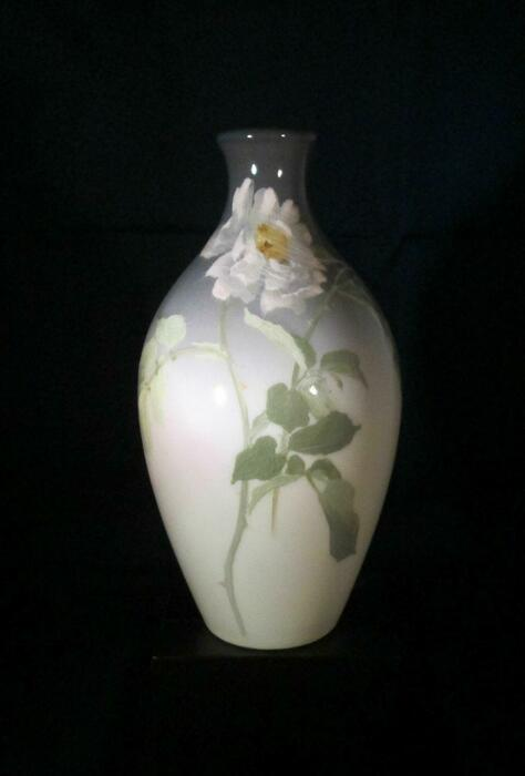 grey green and white pottery vase with rose design
