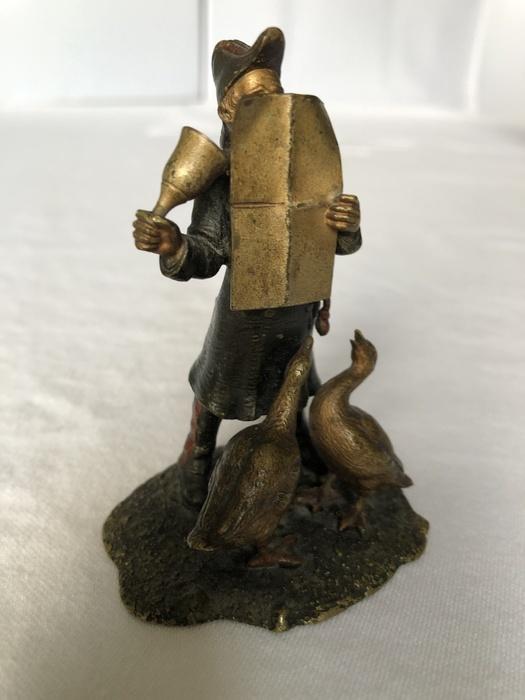 bronze figurine of town crier