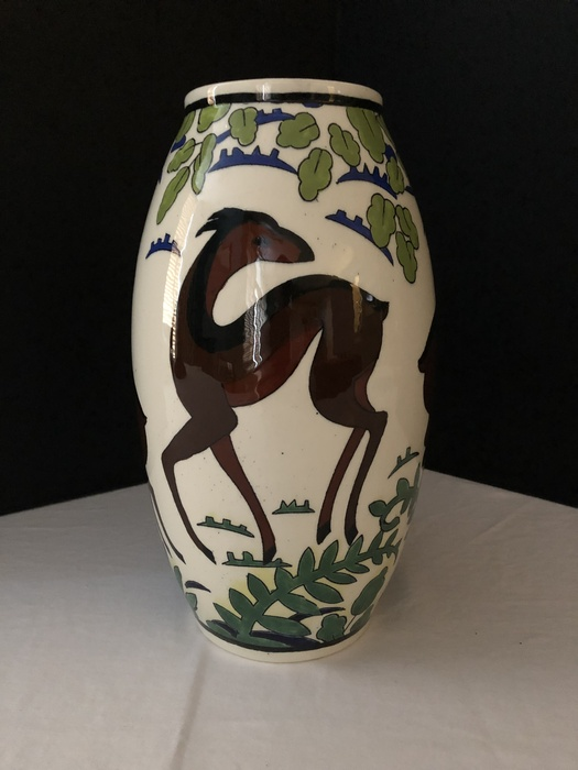 vase with deer decoration