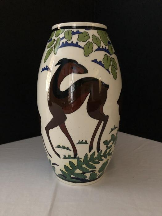 vase with deer decoration