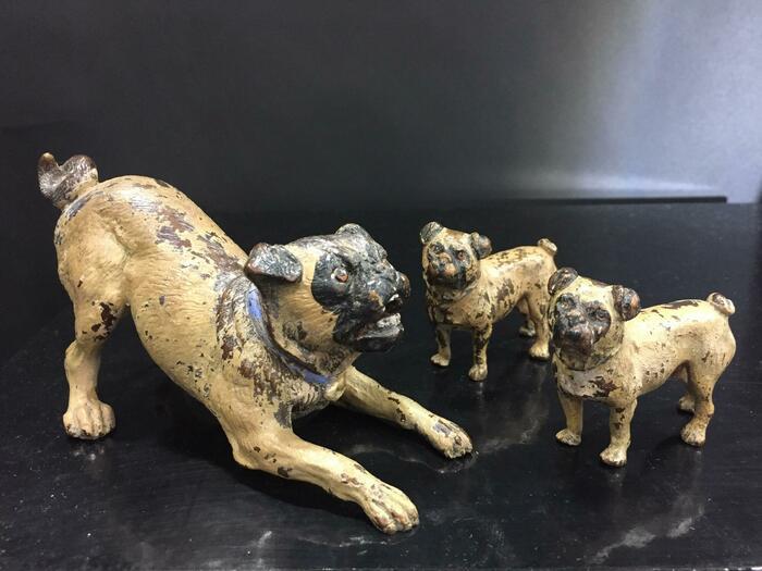 bronze miniatures of 3 pugs