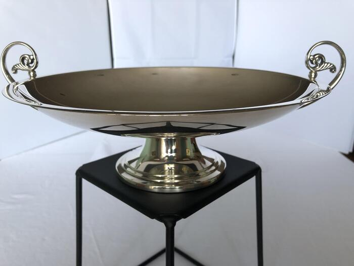 sterling footed handled compote on black stand with white background